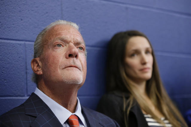 Indianapolis Colts owner Jim Irsay listens as Colts quarterback Andrew Luck speaks during a news conference following the team's NFL preseason football game against the Chicago Bears, Saturday, Aug. 24, 2019, in Indianapolis. The oft-injured star is retiring at age 29. (AP Photo/AJ Mast)