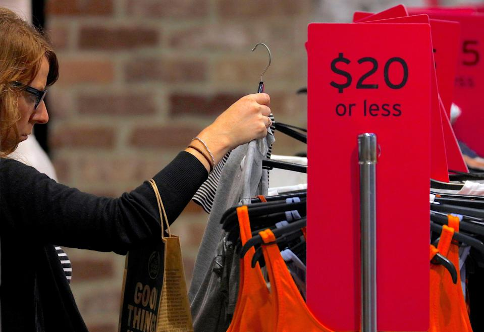 FILE PHOTO: A shopper looks at clothes on sale at a retail store located in a shopping mall in central Sydney, Australia, March 19, 2017. REUTERS/Steven Saphore/File Photo GLOBAL BUSINESS WEEK AHEAD SEARCH GLOBAL BUSINESS 8 JAN FOR ALL IMAGES