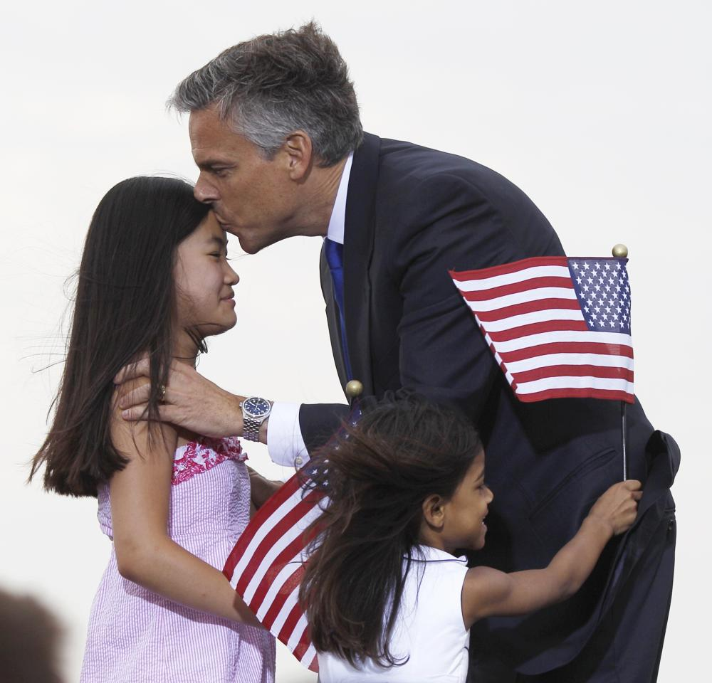 Republican presidential candidate, former Utah Gov. Jon Huntsman kisses his daughter while his other daughter rushes him, after he announced his bid, Tuesday, June 21, 2011 , at Liberty State Park in Jersey City, N.J. (AP Photo/Mel Evans)