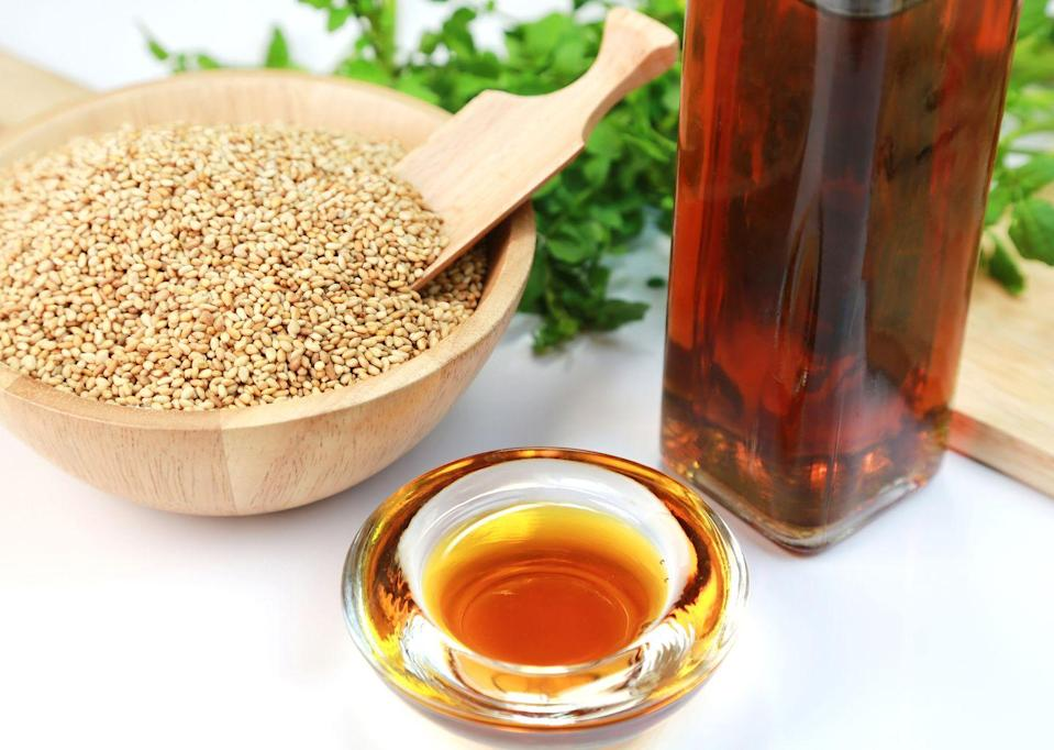 """<p>Sesame oil is rich in both monounsaturated and polyunsaturated fats, and it is also low in saturated fat. It also contains sesamol and sesamin which are powerful antioxidants. There is <a href=""""https://www.nutraingredients.com/Article/2003/04/29/Sesame-oil-to-lower-blood-pressure#"""" rel=""""nofollow noopener"""" target=""""_blank"""" data-ylk=""""slk:evidence"""" class=""""link rapid-noclick-resp"""">evidence </a>that sesame oil can potentially reduce blood pressure as well. Expeller-pressed is the best kind of sesame oil, since the oil from the seeds is extracted at a cooler temperature and this is considered cold pressed. Toasted sesame oil involves seeds that are roasted beforehand, but the extraction process is the same. Since toasted sesame oil adds a lot of flavor, it pairs well in stir frys and makes a great alternative to peanut oil if you have a peanut allergy. </p><p><strong>Best for: </strong>Sautéing, stir fry, frying</p><p><strong>Smoke point: </strong>450°F<br></p><p><strong>Nutritionist pick: </strong><a href=""""https://go.redirectingat.com?id=74968X1596630&url=https%3A%2F%2Fwww.instacart.com%2Fproducts%2F173480-napa-valley-naturals-organic-toasted-sesame-oil-12-0-fl-oz&sref=https%3A%2F%2Fwww.goodhousekeeping.com%2Fhealth%2Fdiet-nutrition%2Fg32108013%2Fhealthiest-cooking-oils%2F"""" rel=""""nofollow noopener"""" target=""""_blank"""" data-ylk=""""slk:Napa Valley Naturals Organic Toasted Sesame Oil"""" class=""""link rapid-noclick-resp"""">Napa Valley Naturals Organic Toasted Sesame Oil</a><br><br></p>"""