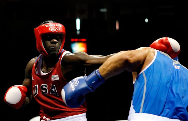 BEIJING - AUGUST 22: Clemente Russo of Italy (blue) fights Deontay Wilder of the United States (red) in the Men's Heavy (91kg) Semifinal at the Workers' Indoor Arena on Day 14 of the Beijing 2008 Olympic Games on August 22, 2008 in Beijing, China. Russo won the bout. (Photo by Harry How/Getty Images)