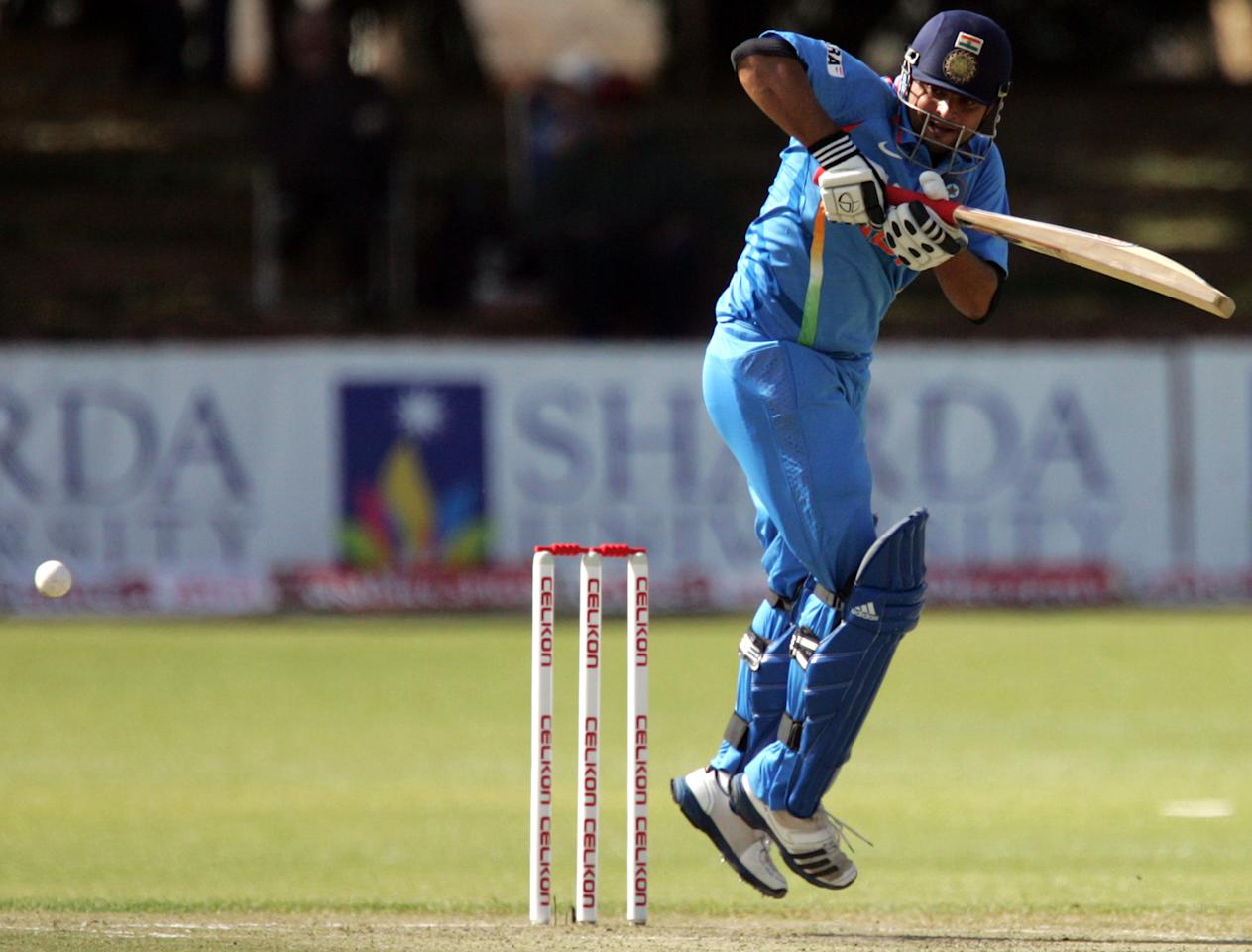 Indian batsman Suresh Raina is pictured in action during the 4th match of the 5-match cricket ODI series between Zimbabwe and India at Queen's Sports Club in Harare on August 1, 2013. AFP/PHOTO Jekesai Njikizana        (Photo credit should read JEKESAI NJIKIZANA/AFP/Getty Images)