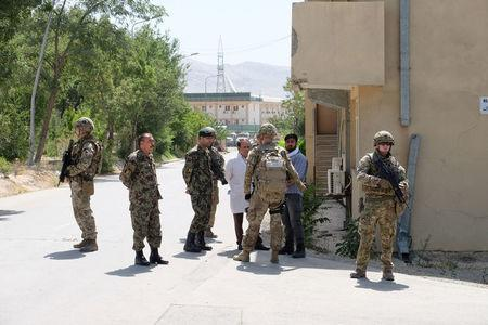 Soldiers with the British army's Royal Irish Regiment provide security for a meeting between international military advisers and Afghan officials at a base in Kabul, Afghanistan July 12, 2017. REUTERS/Josh Smith