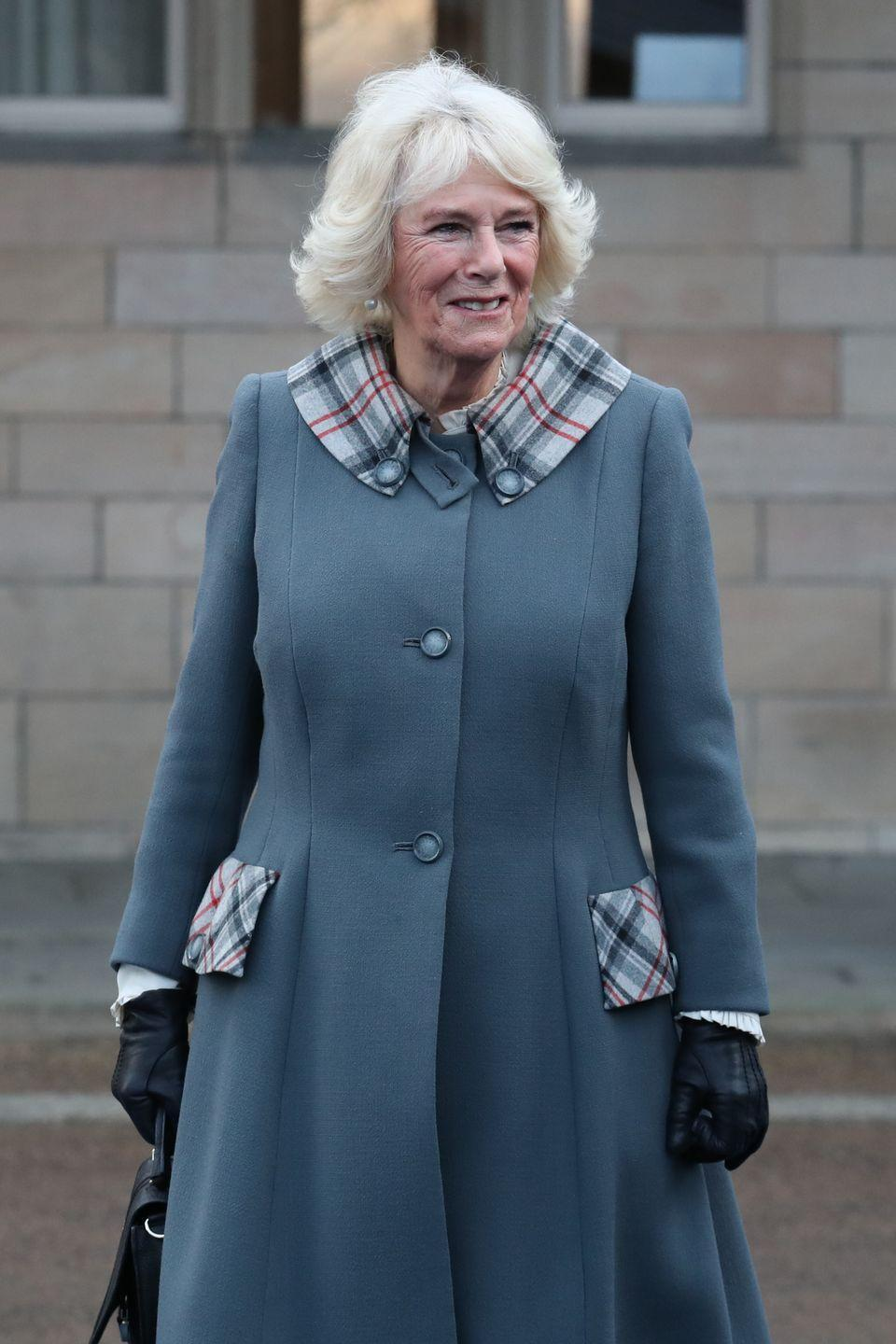 <p>Camilla wore this adorable gray coat with plaid detailing to the University of Aberdeen. There, she presented an honorary degree to her sister-in-law, the Princess Royal. </p>