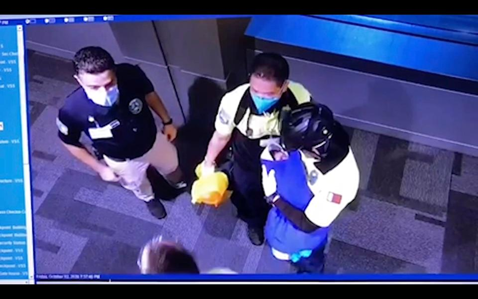 This image made from Oct. 2, 2020 surveillance camera footage obtained by the website Doha News shows officials care for an abandoned baby at Hamad International Airport in Doha, Qatar. Qatar apologized Wednesday, Oct. 28, 2020, after authorities forcibly examined female passengers from a Qatar Airways flight to Sydney to try to identify who might have given birth to the abandoned newborn baby, even as Australia said it was only one of 10 flights subjected to the searches. (Doha News via AP)AP