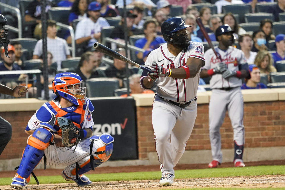 Atlanta Braves' Abraham Almonte watches his two-run home run during the third inning of the team's baseball game against the New York Mets, Tuesday, July 27, 2021, in New York. (AP Photo/Mary Altaffer)