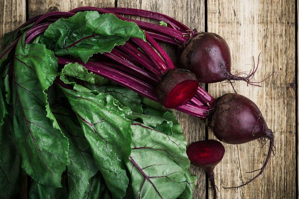 """<p>Fresh beets can be tough to cut and may end up staining your hands a bit (pro tip: wear gloves when slicing!), but they're worth the extra work. Full of flavor, they'll make you never want to eat a jarred beet again. Megan Wong, a registered dietitian working with<a href=""""https://www.algaecal.com/expert-insights/category/nutrition/"""" rel=""""nofollow noopener"""" target=""""_blank"""" data-ylk=""""slk:AlgaeCal"""" class=""""link rapid-noclick-resp""""> AlgaeCal</a>, told Redbook that beets in the spring are young, meaning they're smaller, cook faster, and taste even sweeter. </p><p>""""Beets are low-calorie and high in fiber... which is the perfect combination if you're trying to manage your weight,"""" Wong explained. """"They're also high in potassium and nitrates, which are great for improving circulation and lowering blood pressure!"""" And don't even think about tossing the leafy greens attached to the thick stems—Wong says they are high in vitamins C and K. </p><p>How should you prepare them? """"I love my spring beets roasted, with a maple balsamic drizzle, or baked as fries—I keep it simple with a little salt and pepper,"""" she says. As for the greens: """"Chop them up and sauté them with some garlic and balsamic vinegar. YUM!"""" </p>"""