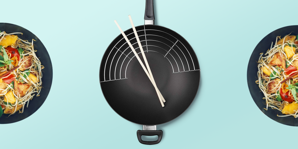 """<p>Woks date back 2,000 years to the Han Dynasty in China. The word """"wok"""" means """"cooking pot"""" in Chinese, and the <a href=""""https://www.goodhousekeeping.com/cooking-tools/cookware-reviews/g799/best-picks-nonstick-cookware/"""" rel=""""nofollow noopener"""" target=""""_blank"""" data-ylk=""""slk:pans"""" class=""""link rapid-noclick-resp"""">pans</a> are used for a variety of cooking tasks. While woks are best associated with making <a href=""""https://www.goodhousekeeping.com/food-recipes/easy/a47684/sesame-chicken-stir-fry-recipe/"""" rel=""""nofollow noopener"""" target=""""_blank"""" data-ylk=""""slk:stir-fries"""" class=""""link rapid-noclick-resp"""">stir-fries</a> in the U.S., any food that benefits from a centralized heat source and large, consistent cooking area can (and should!) be cooked in a wok. That means woks can be used for braising, making <a href=""""https://www.goodhousekeeping.com/food-recipes/easy/a19303/tomato-sauce-recipe/"""" rel=""""nofollow noopener"""" target=""""_blank"""" data-ylk=""""slk:sauces"""" class=""""link rapid-noclick-resp"""">sauces</a>, <a href=""""https://www.goodhousekeeping.com/easy-soup-recipes/"""" rel=""""nofollow noopener"""" target=""""_blank"""" data-ylk=""""slk:soups"""" class=""""link rapid-noclick-resp"""">soups</a>, <a href=""""https://www.goodhousekeeping.com/appliances/g20719709/best-deep-fryers/"""" rel=""""nofollow noopener"""" target=""""_blank"""" data-ylk=""""slk:deep frying"""" class=""""link rapid-noclick-resp"""">deep frying</a>, steaming and more. </p><p>Woks traditionally have rounded bottoms and very smooth, rounded edges, perfect for heating quickly and evenly over a small flame. They typically have long handles that allow them to be shaken during cooking, sometimes eliminating the need to stir at all. Some contemporary styles come with lids which help with steaming and gently finishing food. While many woks are carbon steel, there are also cast iron, non-stick, aluminum, electric and stainless steel woks. <br></p><p>The experts in the <a href=""""https://www.goodhousekeeping.com/institute/about-the-institute/a19748212/good-housekeeping-institute-p"""