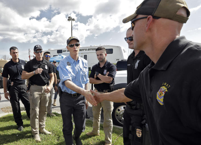 <p>Florida Gov. Rick Scott, center, shakes hands with first responders brought in to help with Hurricane Michael relief Thursday, Oct. 11, 2018, in Panama City Beach, Fla. (Photo: Chris O'Meara/AP </p>