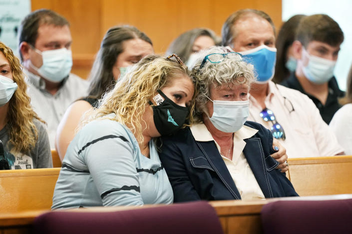 Laura Calderwood, mother of Mollie Tibbetts, right, is comforted as her victim impact statement is read during a sentencing hearing for Cristhian Bahena Rivera, Monday, Aug. 30, 2021, at the Poweshiek County Courthouse in Montezuma, Iowa. Rivera was sentenced to life in prison for the stabbing death of college student Mollie Tibbetts, who was abducted as she was out for a run near her small eastern Iowa hometown in July of 2018. (AP Photo/Charlie Neibergall, pool)
