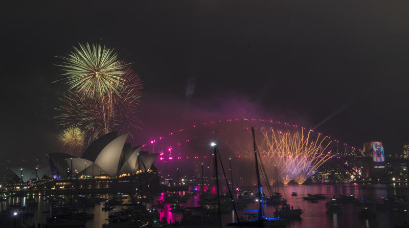 Fireworks explode over the Sydney Harbour during New Year's Eve celebrations in Sydney, Monday, December 31, 2018.