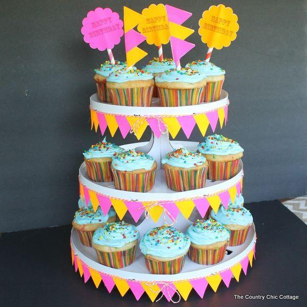 """<p>If you're looking for the perfect way present your birthday cupcakes, then this homemade display stand is sure to do the trick. </p><p><strong><em><a href=""""https://www.thecountrychiccottage.net/decorated-cupcake-stand-labels/"""" rel=""""nofollow noopener"""" target=""""_blank"""" data-ylk=""""slk:Get the tutorial at The Country Chic Cottage"""" class=""""link rapid-noclick-resp"""">Get the tutorial at The Country Chic Cottage</a>. </em></strong></p><p><a class=""""link rapid-noclick-resp"""" href=""""https://www.amazon.com/gp/product/B003IPCUUC?tag=syn-yahoo-20&ascsubtag=%5Bartid%7C10070.g.37055923%5Bsrc%7Cyahoo-us"""" rel=""""nofollow noopener"""" target=""""_blank"""" data-ylk=""""slk:SHOP TREAT STAND"""">SHOP TREAT STAND</a></p>"""