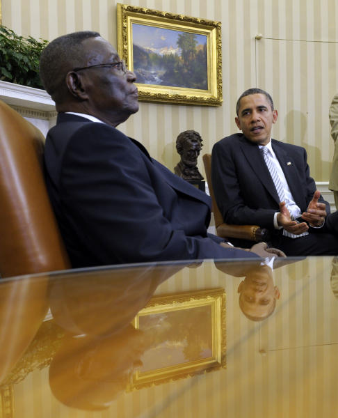 File - in this file photo taken on Thursday, March, 8, 2012, President Barack Obama, right, speaks as President John Evans Atta Mills of Ghana, left, listens during their meeting in the Oval Office of the White House in Washington. State-run television in Ghana is announcing on Tuesday, July 24, 2012, that President John Atta Mills has died at age 68. (AP Photo/Susan Walsh, file)