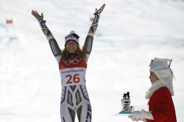 Gold medal winner Ester Ledecka, of the Czech Republic, celebrates during the flower ceremony after the women's super-G at the 2018 Winter Olympics in Jeongseon, South Korea, Saturday, Feb. 17, 2018. (AP Photo)