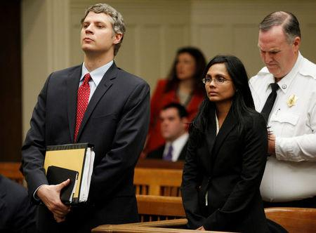 FILE PHOTO:  Annie Dookhan, a former chemist at the Hinton State Laboratory Institute, stands beside her lawyer Nick Gordon (L) during her arraignment at Brockton Superior Court in Brockton, Massachusetts January 30, 2013.  REUTERS/Jessica Rinaldi/File Photo