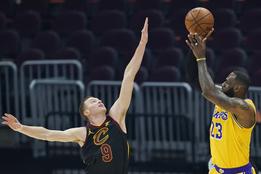 Los Angeles Lakers' LeBron James (23) shoots over Cleveland Cavaliers' Dylan Windler (9) in the first half of an NBA basketball game, Monday, Jan. 25, 2021, in Cleveland. (AP Photo/Tony Dejak)