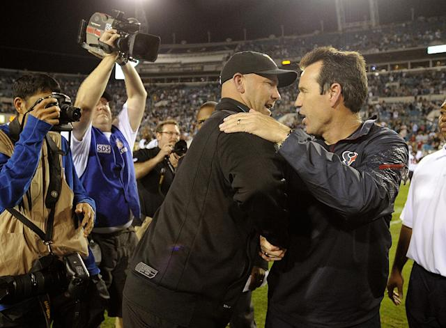 Jacksonville Jaguars head coach Gus Bradley, left, shakes hands with Houston Texans head coach Gary Kubiak, right, after an NFL football game, Thursday, Dec. 5, 2013, in Jacksonville, Fla. Jacksonville beat Houston 27-20. (AP Photo/Stephen Morton)