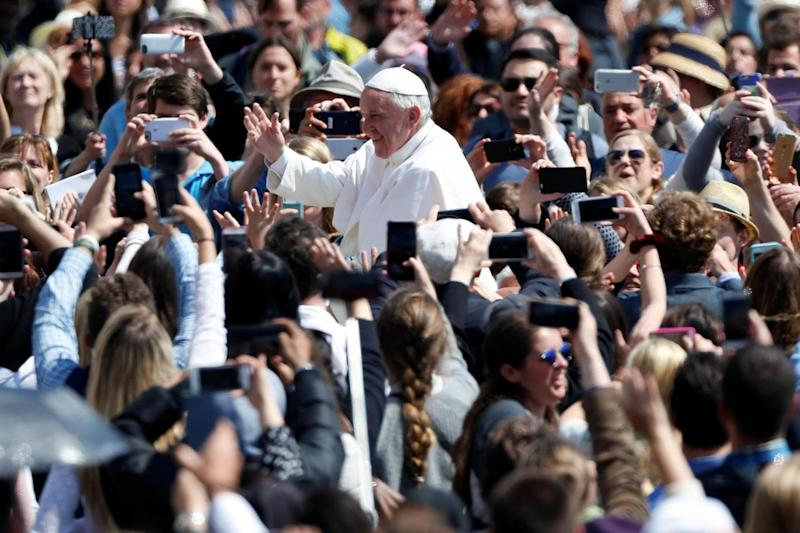 Star: Pope Francis waving to excited crowds at the Easter Sunday Mass in Vatican City. (REUTERS)