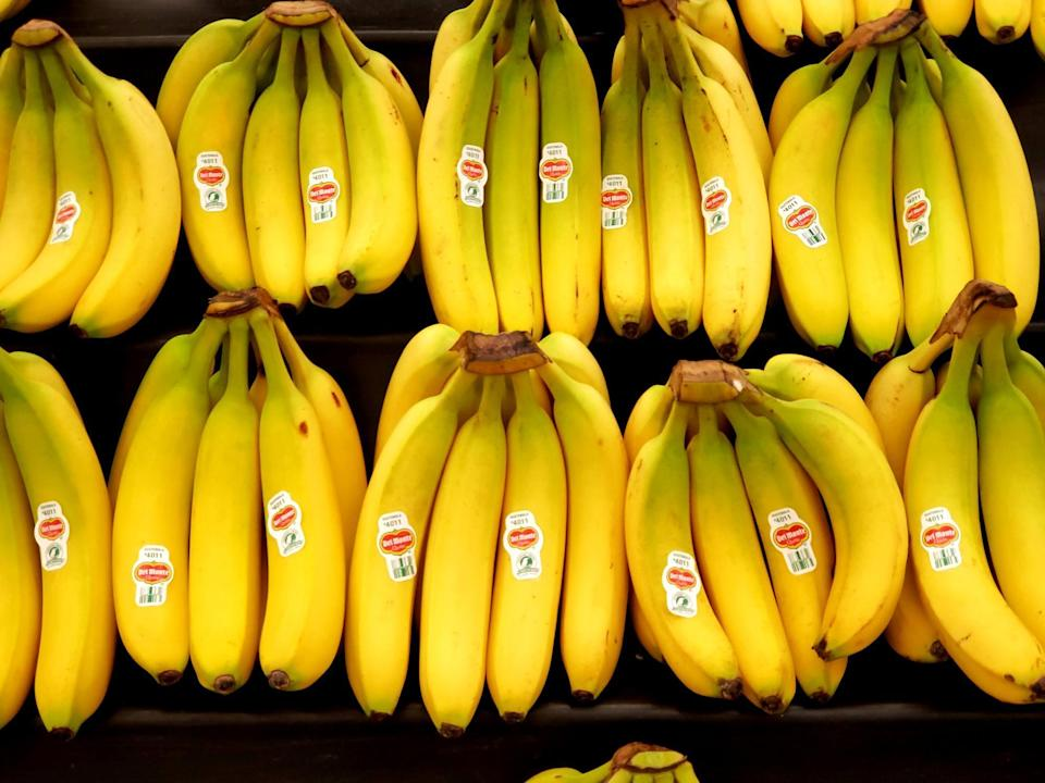 """<p>Bananas are a great food to eat if you want to <a href=""""https://www.theactivetimes.com/healthy-living/15-foods-boost-your-immune-system?referrer=yahoo&category=beauty_food&include_utm=1&utm_medium=referral&utm_source=yahoo&utm_campaign=feed"""" rel=""""nofollow noopener"""" target=""""_blank"""" data-ylk=""""slk:boost your immune system"""" class=""""link rapid-noclick-resp"""">boost your immune system</a>. The only issue is by the time one banana is ripe enough to eat, the whole bunch becomes too ripe in a matter of days, due to the release of ethylene gas. To slow down the process, wrap some plastic wrap tightly around the crown of the bunch, which should extend the shelf life of the bananas by a few days.</p>"""