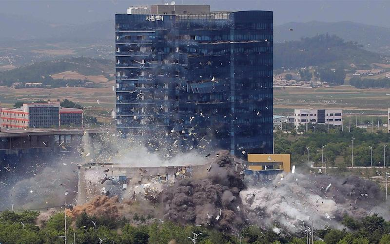 This photo provided by the North Korean government shows the demolition of an inter-Korean liaison office building in Kaesong, North Korea - KCNA via KNS