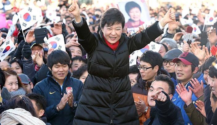 South Korea's presidential candidate Park Geun-hye of ruling Saenuri Party raises her arms during her presidential election campaign in Busan, South Korea, Tuesday, Dec. 18, 2012. South Korea's presidential election is scheduled on Dec. 19. (AP Photo/Yonhap, Lee Ji-eun) KOREA OUT