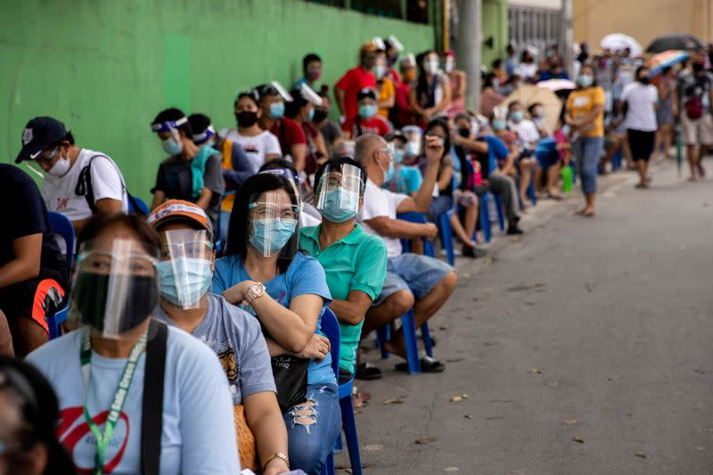 Filipinos queue for government aid amid the coronavirus disease (COVID-19) outbreak, in Quezon