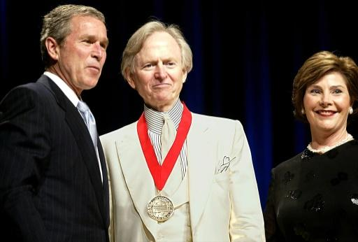 Wolfe, seen here with then president George W. Bush and first lady Laura Bush in 2002 after receiving the National Humanities Medal