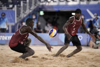 Cherif Younosse, left, of Qatar, returns a shot as teammate Ahmed Tijan watches during a men's beach volleyball semifinal match against the Russian Olympic Committee at the 2020 Summer Olympics, Thursday, Aug. 5, 2021, in Tokyo, Japan. (AP Photo/Felipe Dana)
