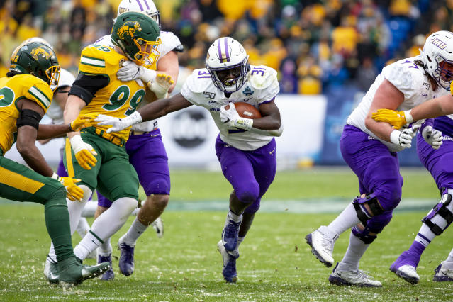 James Madison running back Percy Agyei-Obese (31) runs the ball during the first half of the FCS championship NCAA college football game against North Dakota State, Saturday, Jan. 11, 2020, in Frisco, Texas. (AP Photo/Sam Hodde)