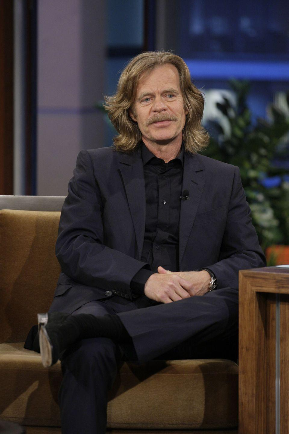 <p>When making the rounds promoting the premiere of his Showtime series, <em>Shameless, </em>Macy paired the long hair he grew out for his role with a robust mustache.</p>