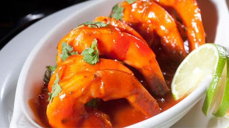 """<p>Chili pepper is the key ingredient in camarones a la diablo. The shrimp based dish packs a wave of heat that's complemented by the addition of tomato sauce, red onion and lime juice.</p> <p><strong><a href=""""https://www.thedailymeal.com/recipes/camarones-la-diabla-recipe-0?referrer=yahoo&category=beauty_food&include_utm=1&utm_medium=referral&utm_source=yahoo&utm_campaign=feed"""" rel=""""nofollow noopener"""" target=""""_blank"""" data-ylk=""""slk:For the Camarones a la Diabla recipe, click here."""" class=""""link rapid-noclick-resp"""">For the Camarones a la Diabla recipe, click here.</a></strong></p>"""