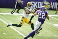 Green Bay Packers wide receiver Allen Lazard (13) catches a pass ahead of Minnesota Vikings free safety Harrison Smith during the second half of an NFL football game, Sunday, Sept. 13, 2020, in Minneapolis. (AP Photo/Bruce Kluckhohn)