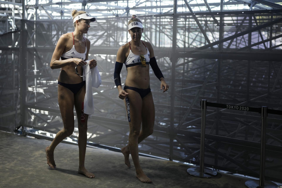 April Ross, right, of the United States, and teammate Alix Klineman prepare for a women's beach volleyball Gold Medal match against Australia at the 2020 Summer Olympics, Friday, Aug. 6, 2021, in Tokyo, Japan. (AP Photo/Felipe Dana)