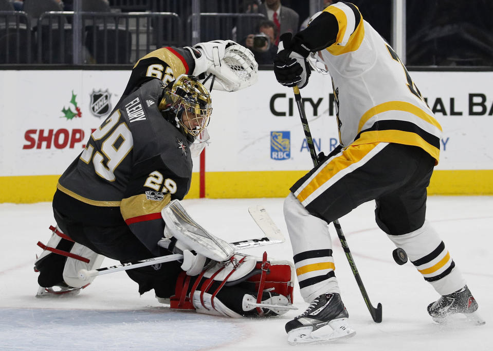 Vegas Golden Knights goalie Marc-Andre Fleury blocks a shot by Pittsburgh Penguins right wing Patric Hornqvist during the second period of an NHL hockey game Thursday, Dec. 14, 2017, in Las Vegas. (AP Photo/John Locher)