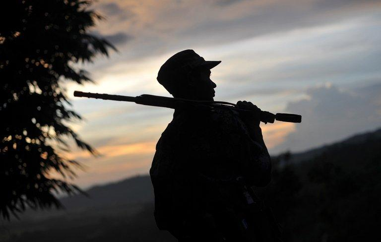 A Kachin rebel looks out from an outpost near the Myanmar town of Laiza on September 22, 2012