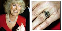 """<p>Camilla Parker-Bowles' unique engagement ring is, in fact, a royal family heirloom, rumoured to have belonged to the Queen Mother - who was very close to Prince Charles. The art-deco style ring is made of platinum and has a square diamond in the middle with three diamonds either side. </p><p><a class=""""link rapid-noclick-resp"""" href=""""https://go.redirectingat.com?id=127X1599956&url=https%3A%2F%2Fwww.libertylondon.com%2Fuk%2Fgold-vermeil-trinny-trilogy-green-amethyst-and-oro-verde-ring-R289659006.html%3Fdwvar_000627323_color%3D25-GOLD%26listsrc%3DRings%23start%3D1&sref=https%3A%2F%2Fwww.elle.com%2Fuk%2Flife-and-culture%2Fwedding%2Fg28785354%2Froyal-family-engagement-rings-meghan-markle-kate-middleton-queen%2F"""" rel=""""nofollow noopener"""" target=""""_blank"""" data-ylk=""""slk:SHOP SIMILAR"""">SHOP SIMILAR </a>Dinny Hall Gold Vermeil Trinny Trilogy Green Amethyst and Oro Verde Ring, Liberty London, £650</p>"""