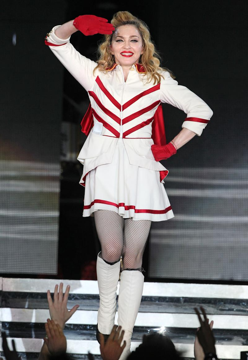 "U.S. singer Madonna performs during her concert at Olympic Hall in Moscow, Russia, Tuesday, Aug. 7, 2012. Madonna has voiced hope that three feminist Russian rockers on trial for performing a ""punk prayer"" against Vladimir Putin are released soon. The pop star told the AP during her concert tour of Russia that she supports freedom of speech and hopes the judge will show leniency. (AP Photo/Mikhail Metzel)"