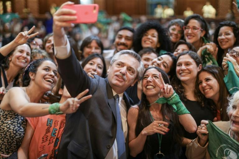 Then president-elect Alberto Fernandez poses for a selfie with women abortion campaigners in Buenos Aires in November 2019 (AFP Photo/ESTEBAN COLLAZO)