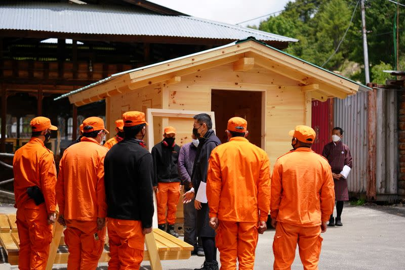 Bhutan's King Jigme Khesar Namgyel Wangchuck visits a group of Desuups training at Carpentry Edelweiss during his visit to remote villages to oversee measures to contain the spread of the coronavirus disease (COVID-19) in Bumthang