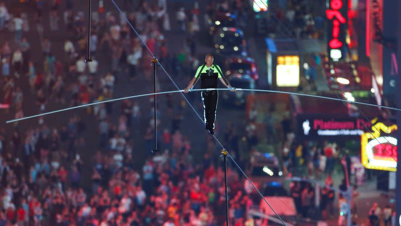 FILE PHOTO:  Aerialist Wallenda walks the highwire with his sister over Times Square in New York