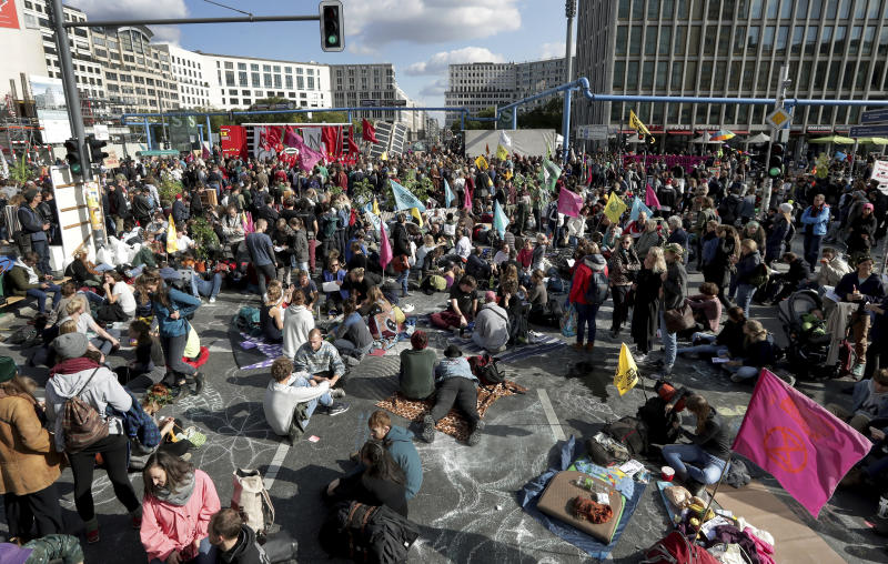 Supporters of the 'Extinction Rebellion' movement block a road at the Potsdamer Platz square in Berlin, Germany, Oct. 7, 2019. (Photo: Michael Sohn/AP)