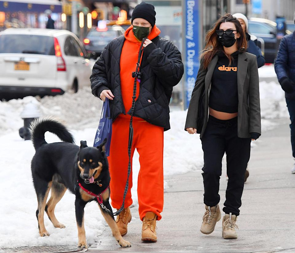 <p>Emily Ratajkowski showed a bit of her baby bump during a walk on the snowy streets of New York City with her husband Sebastian Bear-McClard and their dog.</p>