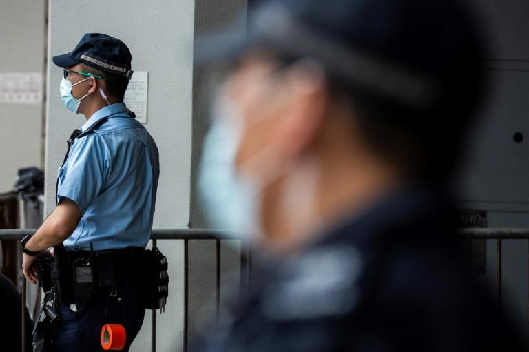 Police stand guard outside the High Court in Hong Kong as Tong Ying-kit faced sentencing after he was convicted of terrorism and inciting secession in the first trial conducted under a national security law imposed by China