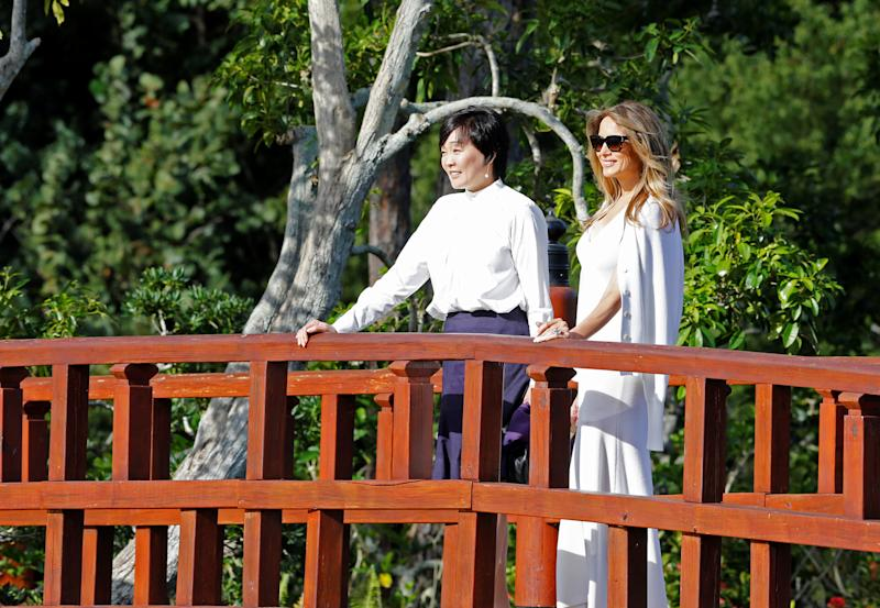 U.S. First Lady Melania Trump (R) and Akie Abe, wife of Japanese Prime Minister Shinzo Abe, tour Morikami Museum and Japanese Gardens in Delray Beach, Florida, U.S., February 11, 2017.  REUTERS/Joe Skipper