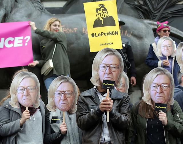 <p>Members of the global citizen movement AVAAZ wear masks depicting the face of former National Front party leader Jean-Marie Le Pen with the hair of his daughter and French far-right presidential candidate, Marine Le Pen, as they stage a protest as part of a May Day rally in Paris, France, Monday, May 1st, 2017. With just six days until a French presidential vote that could define Europe's future, far-right leader Marine Le Pen and centrist Emmanuel Macron are holding high-stakes rallies Monday. (AP Photo/Thibault Camus) </p>