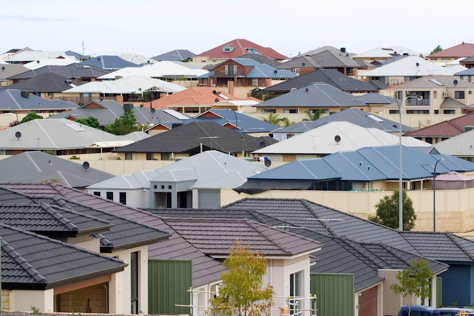 Residential houses in a Rockingham Suburb - Western Australia. Typical of modern life this new development shows suburban sprawl as a landscape of roof tops.
