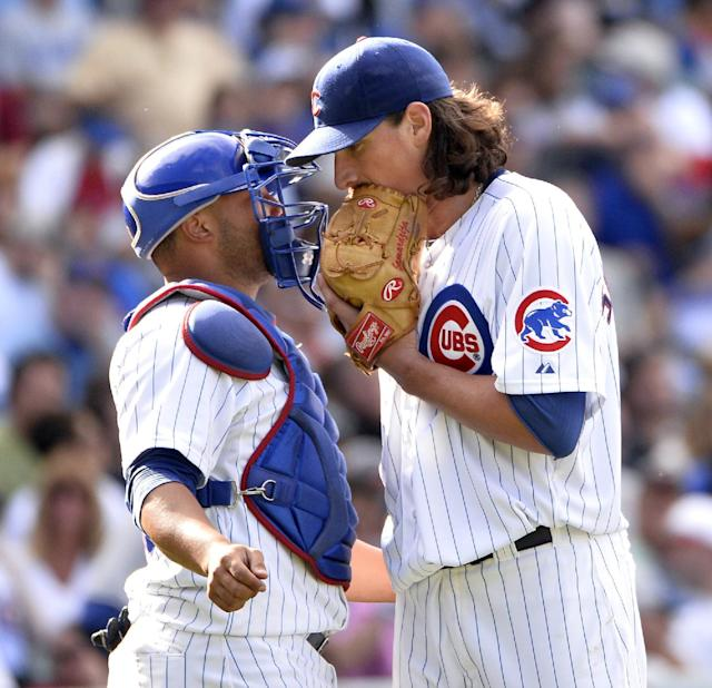 Chicago Cubs catcher Welington Castillo, left, talks with starting pitcher Jeff Samardzija during the sixth inning of a baseball game against the Los Angeles Dodgers, Saturday, Aug. 3, 2013, in Chicago. (AP Photo/Brian Kersey)