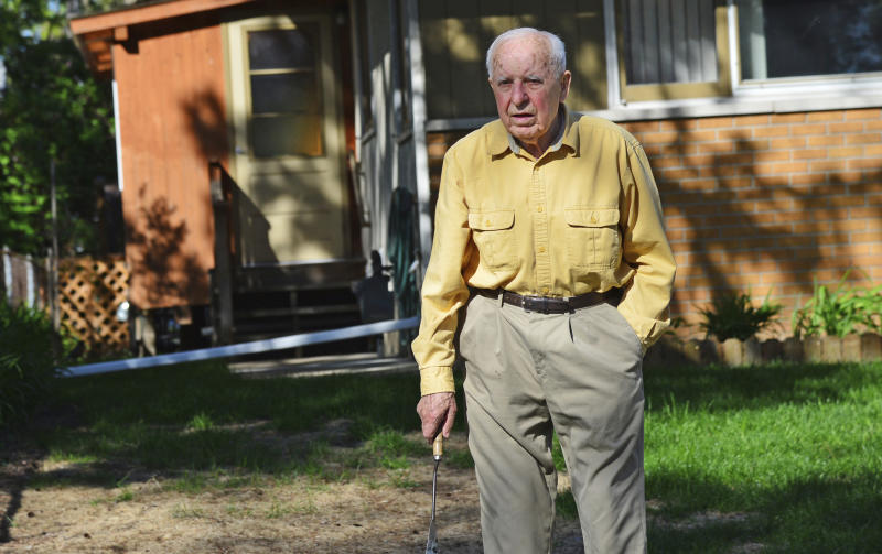 FILE - In this May 2014 file photo, Michael Karkoc works in his yard in Minneapolis. Karkoc, a retired Minnesota carpenter whom The Associated Press exposed as a former commander of a Nazi-led unit accused of war atrocities, died Dec. 14, 2019, according to cemetery and public records. He was 100. His family maintained that he was never a Nazi or committed any war crimes. (Richard Sennott/Star Tribune via AP)