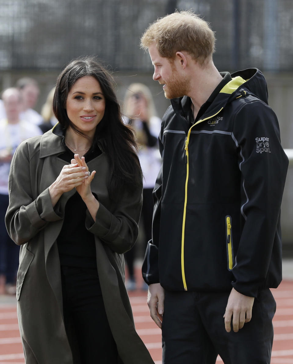 """<p>However, while the soon-to-be royal looked stunning, as usual, it was what she wasn't wearing that caught the eye of some royal watchers. While Markle is usually spotted with a chic clutch or crossbody bag (she has an impressive collection from Strathberry), she was noticeably handbag-free on Friday — and, as unimportant as it may seem, <a rel=""""nofollow"""" href=""""https://ca.style.yahoo.com/meghan-markle-broke-two-royal-traditions-one-day-174123536.html"""" data-ylk=""""slk:that actually breaks royal tradition;outcm:mb_qualified_link;_E:mb_qualified_link;ct:story;"""" class=""""link rapid-noclick-resp yahoo-link"""">that actually breaks royal tradition</a>. </p>"""