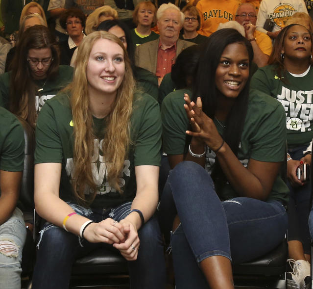 Baylor players Lauren Cox, left, and Kalani Brown, right, watch an NCAA college basketball selection show Monday, March 12, 2018, in Waco, Texas. (Jerry Larson/Waco Tribune-Herald via AP)